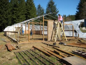 """Hoop house in front """"yard"""".  Currently with no plastic."""